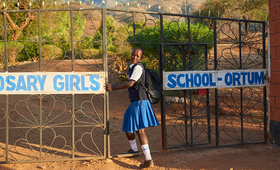"Sharleen, aged 17, enters the school where she continues her studies in Kenya. Her teachers supported her to resist mutilation and early marriage. ""My family wanted me to be cut and get married, but I refused,"" she said.  ""I have stayed firm in pursuing my education."" Photo by Luca Zordan for UNFPA."